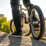 person in black pants riding black bmx bike